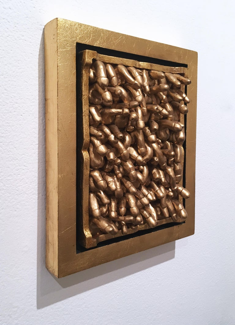 Clay, ceramic, gold leaf, found materials and enamel in gold leafed float frame