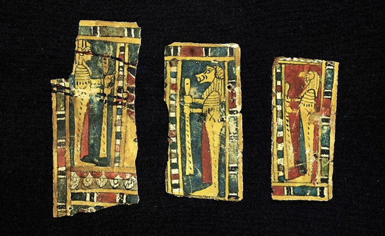 Set of Egyptian cartons with figures of the four gods and various representations of Anubis.   Golden, bright yellow, green, red, white, blue and black paint.  Size: 50 x 35 cm Material: Cartonnage Culture: Egypt, c. 300 a. C. Condition: part of a