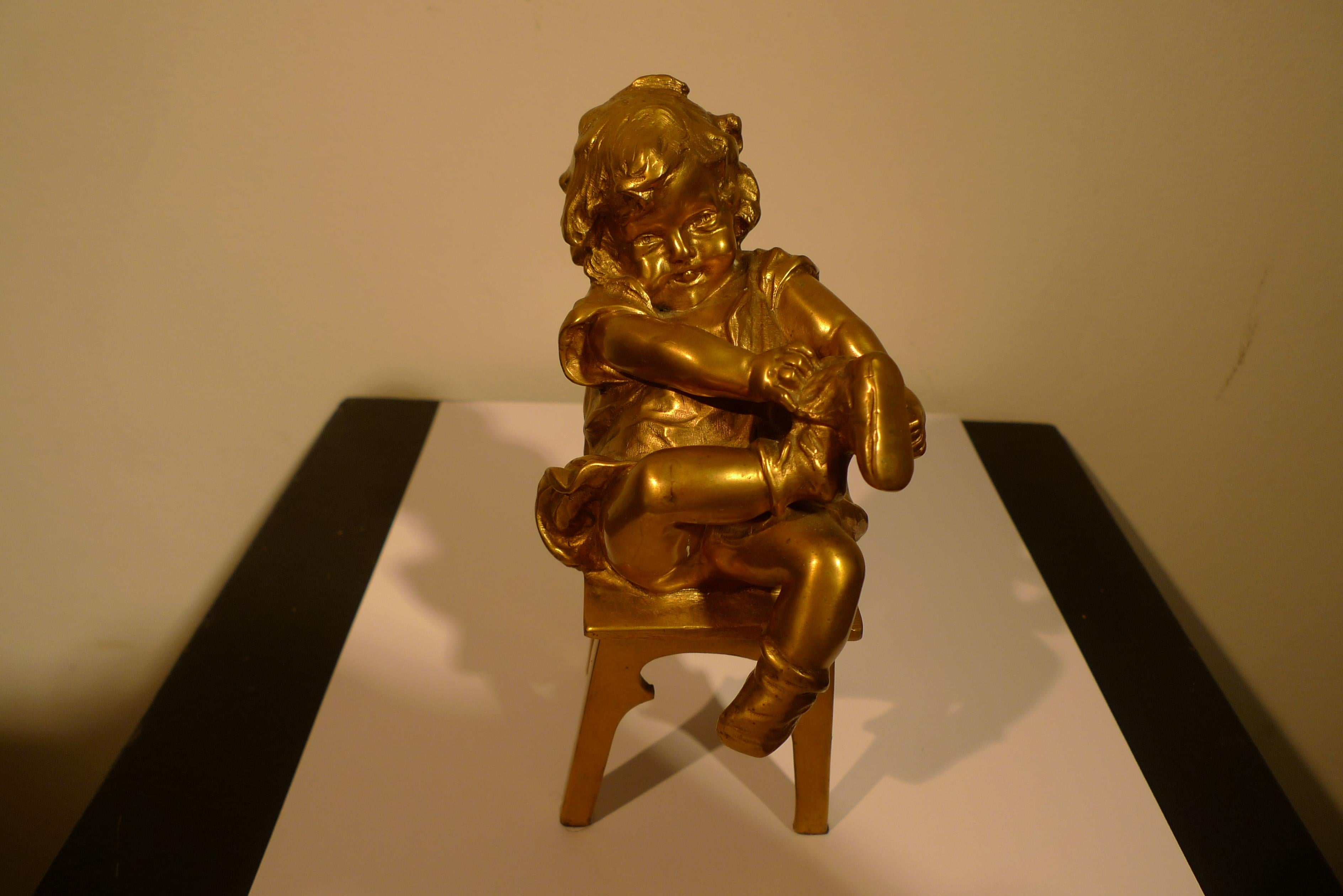 """""""A Girl Sitting on a Stool Tying Her Shoe"""", 20th Century Bronze by Juan Clará"""