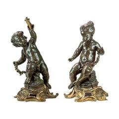 Pair of Figural Sculptures of Seated Cherubs