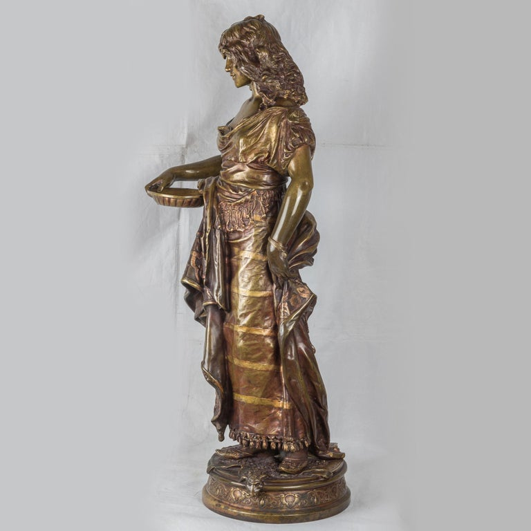 ADRIEN-ETIENNE GAUDEZ  French, (1845-1902)  Gypsy Woman          Signed 'A. GAUDEZ' on base.    33 x 15 inches    NOTES: Cast in patterned, polychrome dress, wearing a bracelet, standing on a sheepskin rug and holding a small salver, raised on a