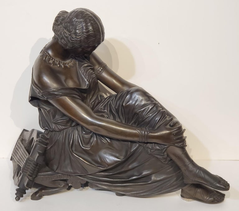 """Antique Bronze Sculpture of the Poet """"Sappho"""".  Bronze Sculpture of a Woman and a Harp or Lyre made by Jean-Jacques Pradier.  This antique bronze sculpture measures 17"""" wide, 14"""" high, 9"""" deep.  Bronze medium brown patina and with Susse Frere"""