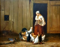 Woman Feeding Her Hens In The Barnyard At The Farm.