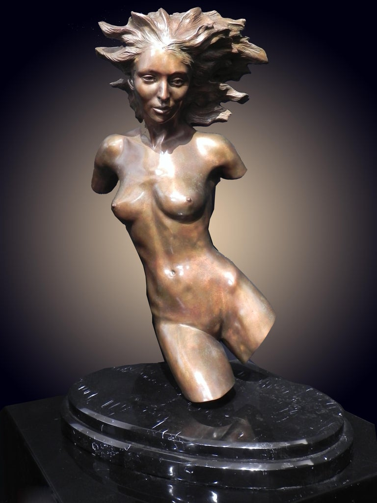 """Metamorphosis"" by Frederick Hart is figurative bronze bust of a woman numbered 17/29.  ""Metamorphosis"" was a journey of transformation for Hart. The work haunted and yet thrilled him. The work contained mysteries that had to be solved. It was"