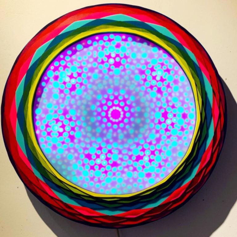 Acrylic on Lasercut wood, LEDs, Ardino, motion censor 30 x 30 x 4 in (76.2 x 76.2 x 10.16 cm)  Christine Romanell was born in Paterson, NJ. Her work focuses on aperiodic patterns as they relate to the underlying structures of reality. She sets up