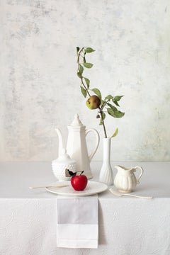 Off White 7 - Still life table tea setting w/ red apple & branch in vase