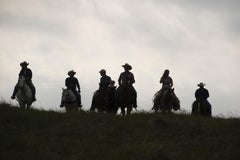 Untitled 4438 - Texas landscape, horseback riders in tall grasses w/ cloudy sky