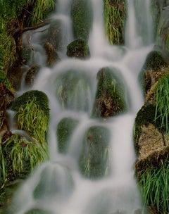 Flowing Water - Misty waterfall nature landscape w/ rocks & lush green plants
