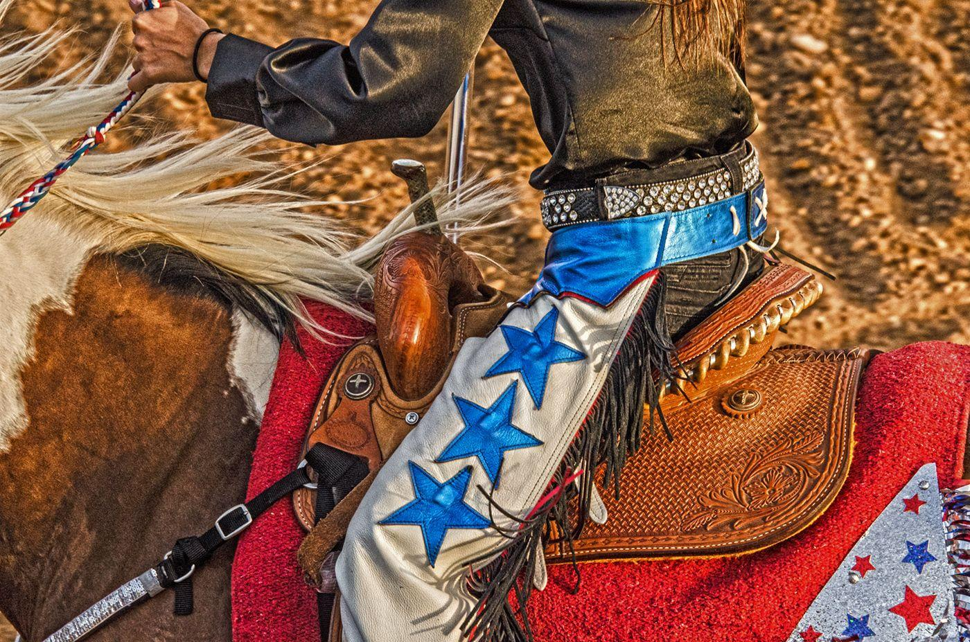 Star Saddle - Red, white & blue saddle and chaps, Texas rodeo rider and horse