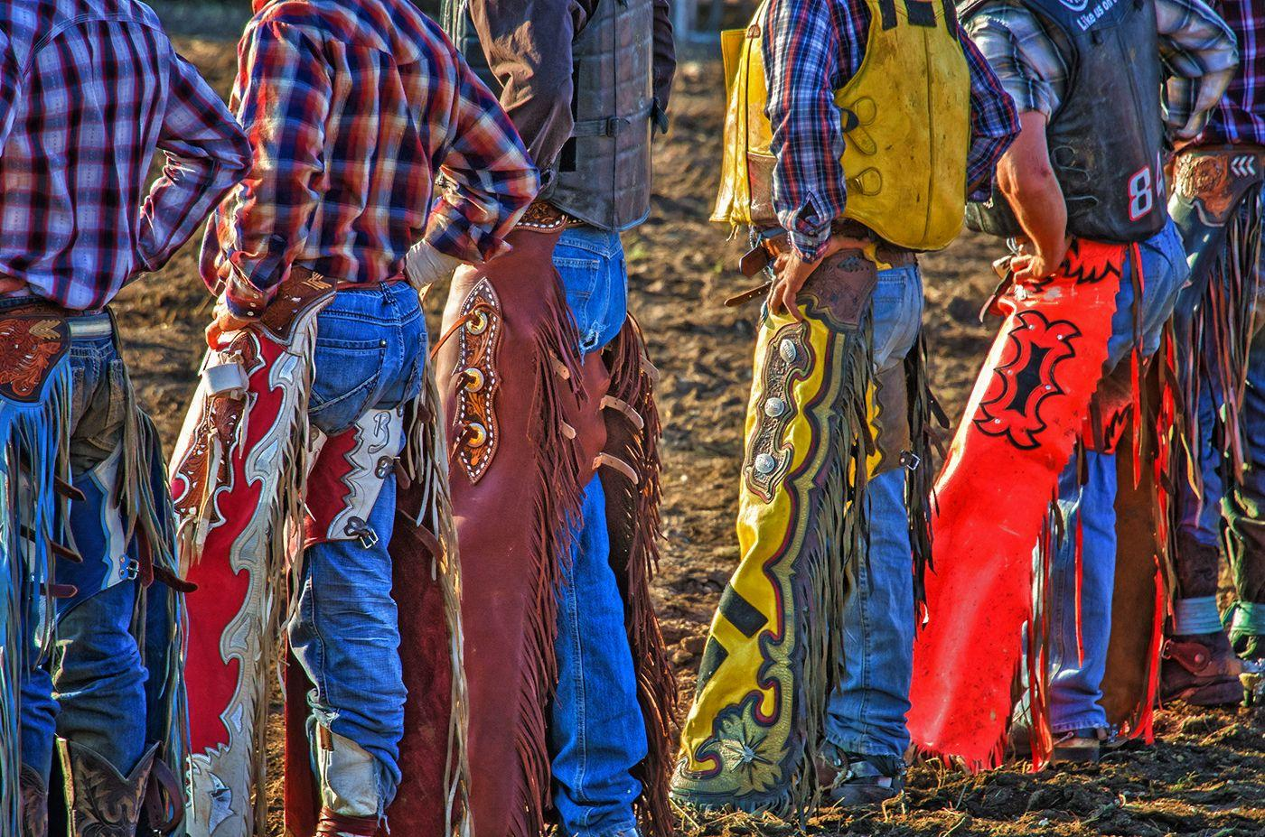 Chaps Rock Springs - Cowboys lined up, colorful fringe chaps & blue jeans