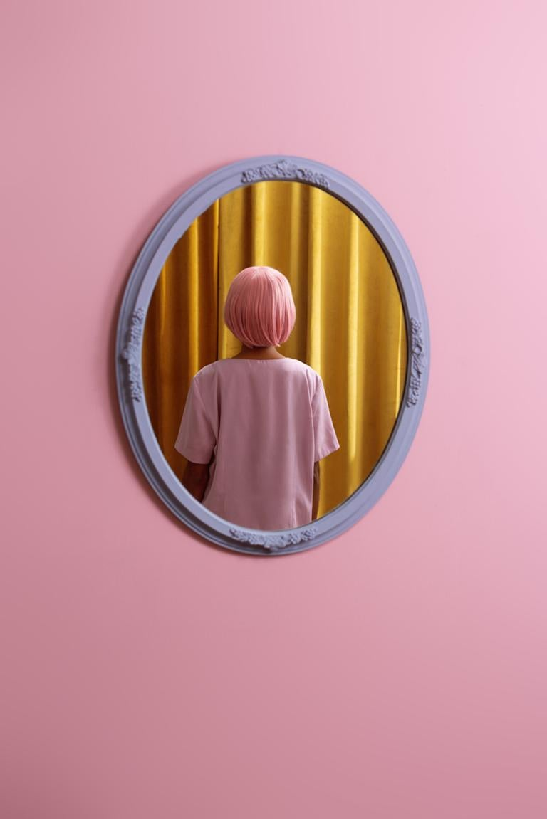 I don't see myself - Abstract pop pink & yellow self-portrait in oval mirror - Beige Abstract Photograph by Karen Navarro