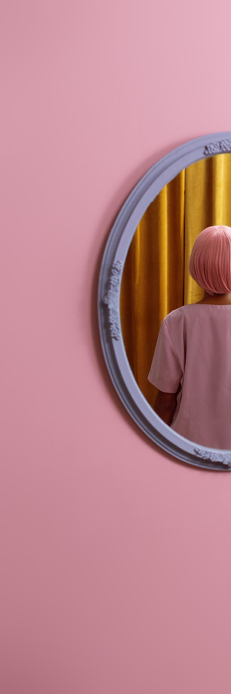 I don't see myself - Abstract pop pink & yellow self-portrait in oval mirror - Photograph by Karen Navarro