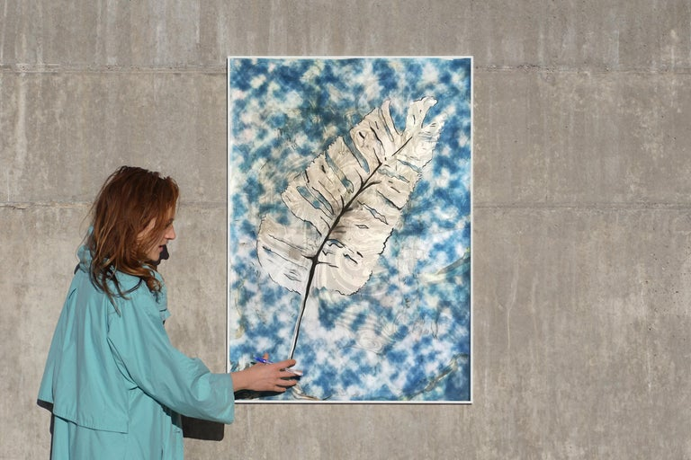 This is a botanical cyanotype print made using natural sunlight. The technique is combined with a Suminagashi marbling that was previously coated on the watercolor paper. It is handmade and unique.  Details: + Title: Botanical Leaf with a Marbling