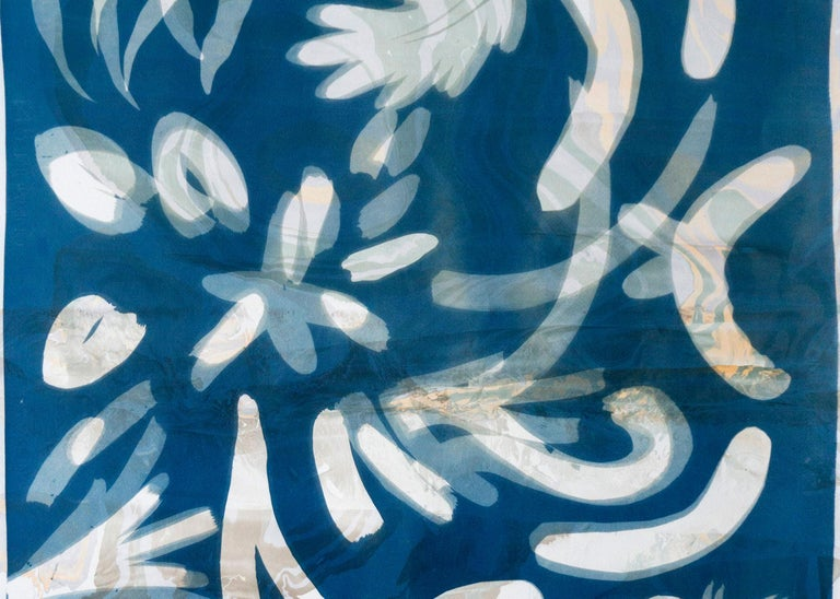 This is a contemporary botanical cyanotype print made using natural sunlight. The technique is combined with a Suminagashi marbling (a traditional japanese technique), that was previously coated on the watercolor paper. It is handmade and