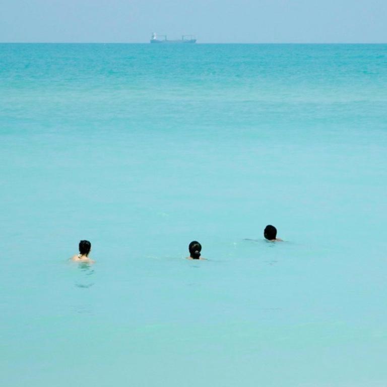 Waiting, Miami Beach - Photorealist Photograph by Alberto Coto