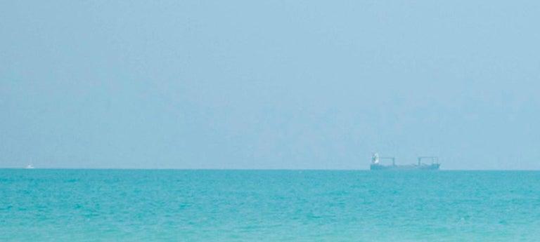 Waiting, Miami Beach - Blue Landscape Photograph by Alberto Coto
