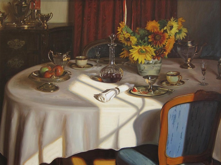 Realistic interior oil on canvas by American artist Evan Wilson.  A white table clothed dining room table is set with sunflowers a silver tea pot, bowl of apples and additional settings.  A bright swatch of sunlight streaks across the scene.    The