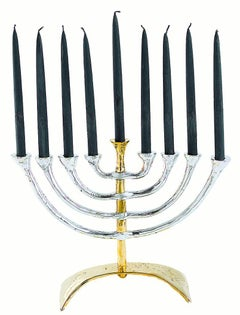 Menorah classica, designed and produced by David  Marshall, aluminium and brass