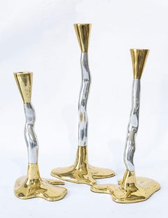 Puzzle candelabra designed  by David Marshall, produced in sand cast alu./brass