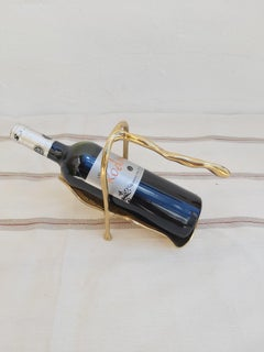 GLOVE WINE POURER DESIGNED AND PRODUCED BY THE ARTIST DAVID MARSHALL IN BRASS