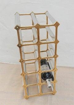MULTIPLE BOTTLE RACK, HANDMADE,DESIGNED BY DAVID MARSHALL, SAND CAST BRASS/ALU.