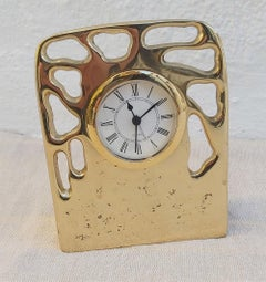 Perforated clock, handmade, designed and produced by DM, sand cast brass