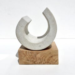 You III, Richard Fox. Small abstract stone sculpture on oak plinth, carved
