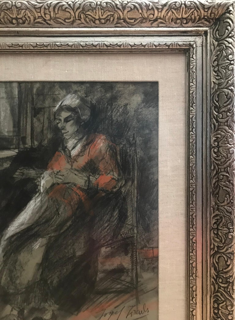 Charcoal and oil pastel on paper of a woman mending by the famous Dutch artist, Josef Israels. In very good condition with no issues. Signed lower right. Circa 1890.  Framed in a more recent antique silver frame with silk mat also in very good