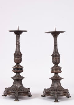 Pair of candlesticks in bronze with dark brown patina
