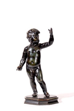 Standing child with right hand raised, bronze statuette