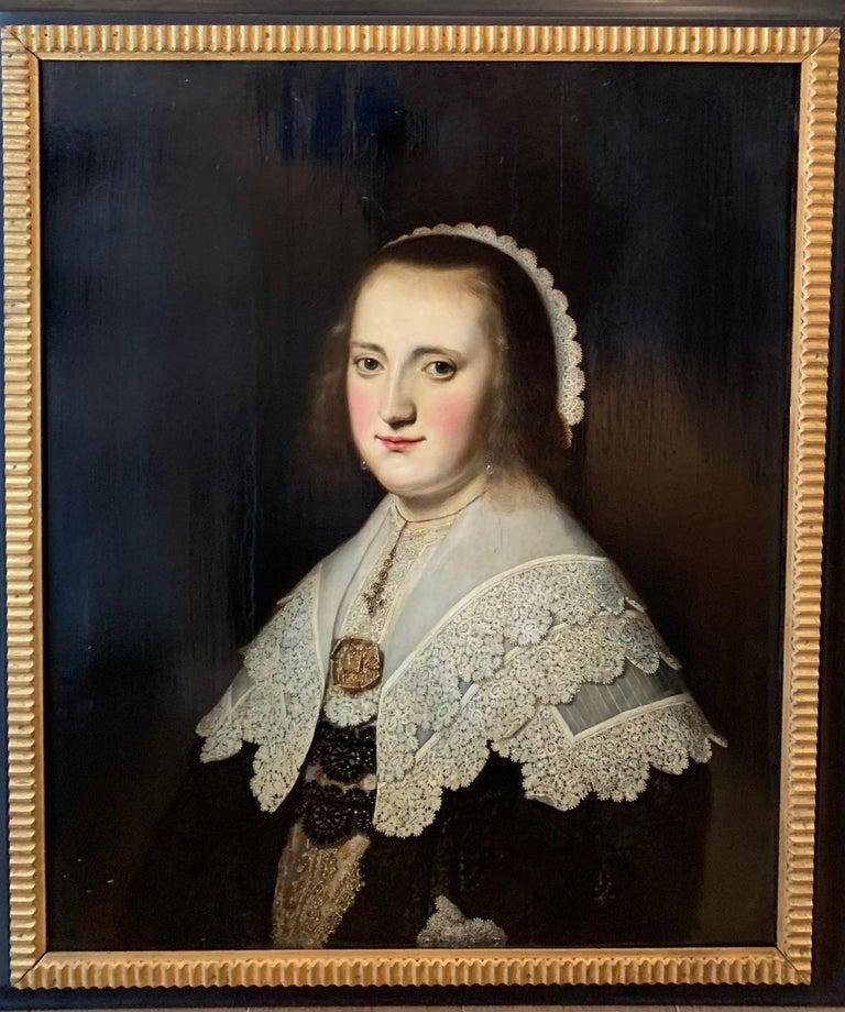 Paulus Hennekin Figurative Painting - 17th century Dutch Old Master Portait of a lady - lace collar jewellery