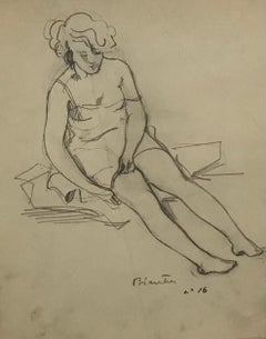 Young woman sitting undressing