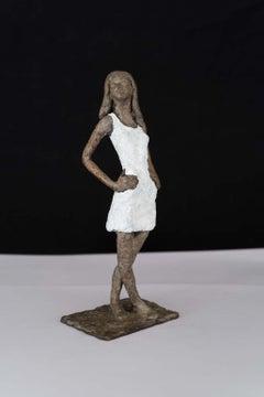 Girl in Mini - contemporary bronze sculpture, nude female with white dress