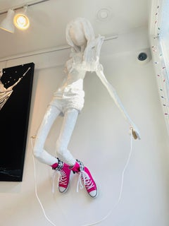 Wall Mounted Sculpture of a Girl with a Skipping Rope. Title - The Skipping Girl