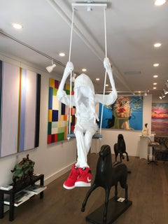 Suspended Ceiling Sculpture of a Girl on a Swing. Title - Girl on a Swing