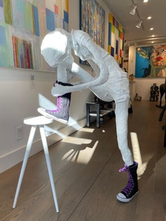Floor Sculpture of a Girl Tying Her Shoe on a Stool. Title - Girl Tying Her Shoe