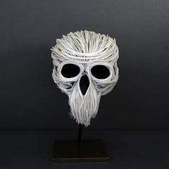 Charlette, Skull, Recycled feathers on resin, base in brass