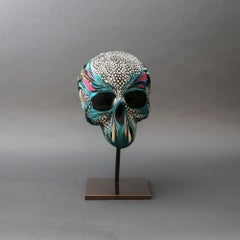Adelaïde, Skull, Recycled feathers on resin, base in brass