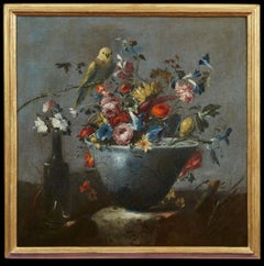 Italian still life painting with flowers and a parrot by Pseudo Guardi