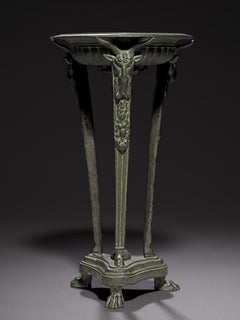 An Italian patinated bronze athenienne tripod stand 19th Century