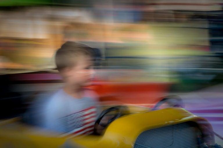 Mark Cáceres Figurative Photograph - Boy with American Flag Shirt, Cummington Fair