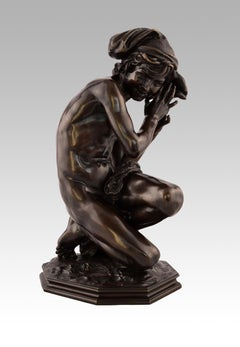 19th Century bronze sculpture of a boy with a shell