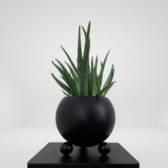 Arty decorative hand-made plant pot, black with black glossy legs