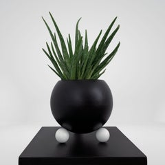 Arty decorative hand-made plant pot, black with white legs