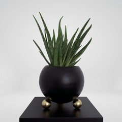 Arty decorative hand-made plant pot, black with gold legs