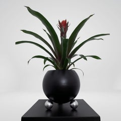 Arty decorative hand-made plant pot, black with silver legs