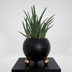 Arty decorative hand-made plant pot, black with rose gold legs