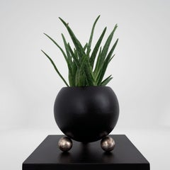 Arty decorative hand-made plant pot, black with pure marbled silver legs