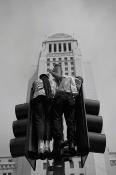 Revolution & Rebirth, black and white photograph of two figures protesting