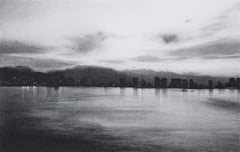 Irrepressible 13, black and white charcoal drawing of lake scene with city